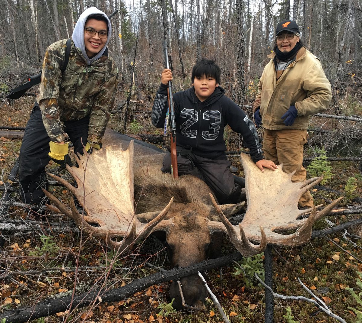 Thomas Bergman, left, Tyler Bergman and their uncle Walter Bergman pose on Sept. 22, 2017, with a big bull moose that Tyler and uncle P.J. Simon shot in an area near the Brooks Range. (Photo by P.J. Simon)