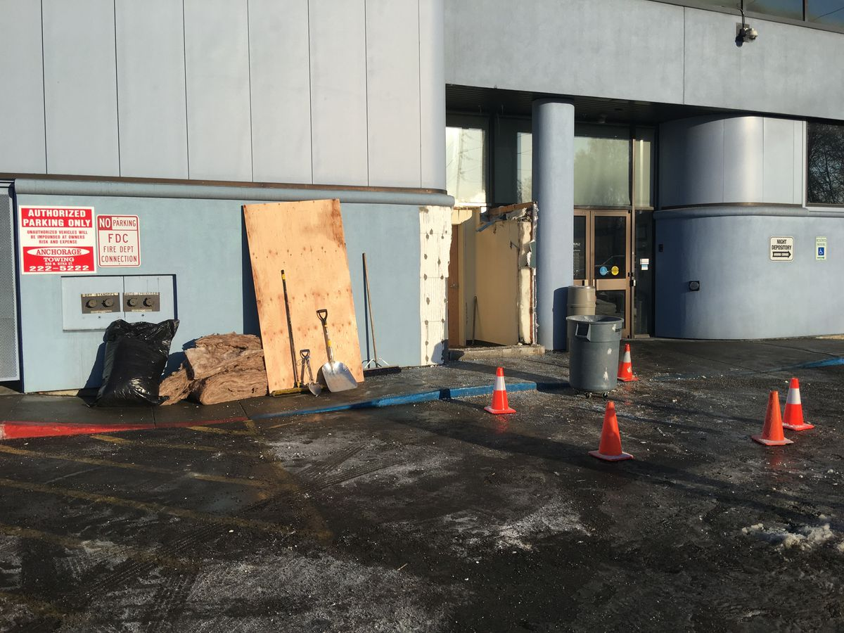 An exterior wallof a Denali Federal Credit Union Bank was damaged early Monday when an ATM was forcibly removed from the wall. (Chris Klint / Alaska Dispatch News)