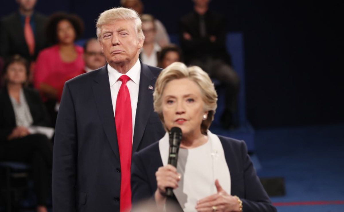 Donald Trump listens as Hillary Clinton answers a question from the audience during the second presidential debate Sunday, Oct. 9, 2016. (Rick Wilking / Reuters)