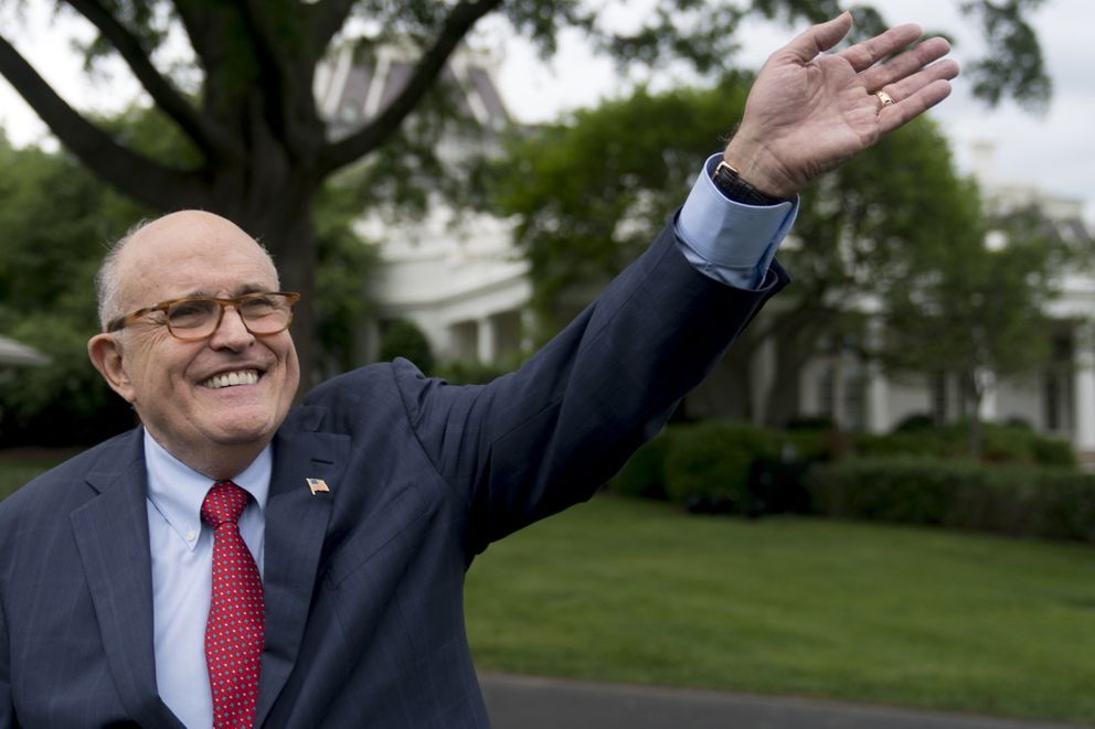 FILE - In this Tuesday, May 29, 2018 file photo, Rudy Giuliani, an attorney for President Donald Trump, waves to people at the White House. (AP Photo/Andrew Harnik, File)