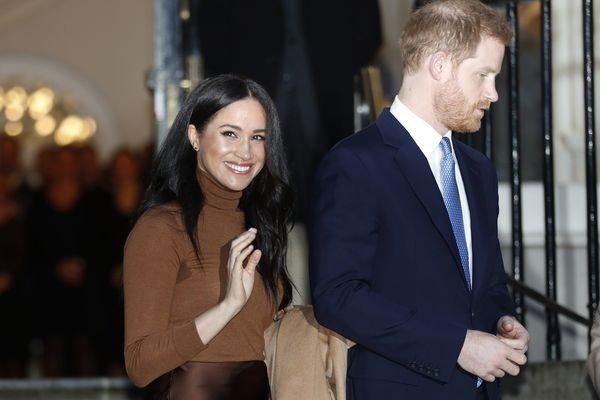 FILE - In this Jan. 7, 2020, file photo, Britain's Prince Harry and Meghan, Duchess of Sussex leave after visiting Canada House in London, after their recent stay in Canada. Prince Harry and Meghan Markle are to no longer use their HRH titles and will repay £2.4 million of taxpayer's money spent on renovating their Berkshire home, Buckingham Palace announced Saturday, Jan. 18. 2020. (AP Photo/Frank Augstein, File)