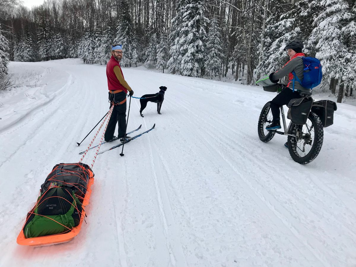Sam Friedman, left, and Suzanna Caldwell are all smiles Monday on our way back to the trailhead after a night at a cabin on Red Shirt Lake in the Nancy Lake State Recreation Area near Willow. (Vicky Ho / ADN)
