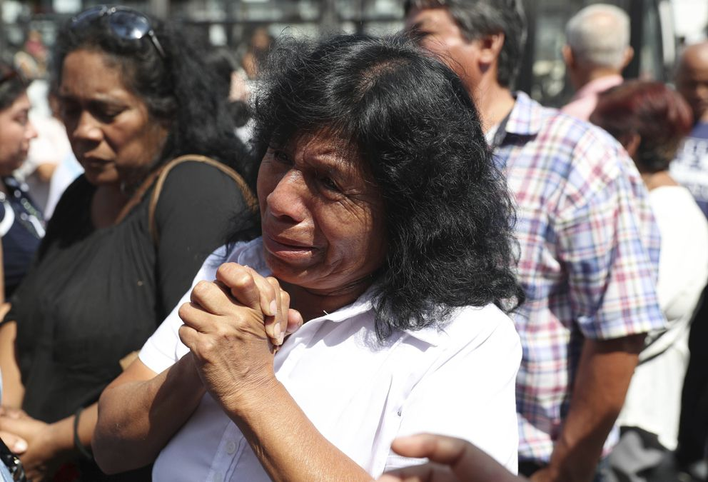 A supporter of former Peruvian President Alan Garcia grieves after learning that the former leader died from a self-inflicted gun shot, outside the hospital where he was taken after he shot himself, in Lima, Peru, Wednesday, April 17, 2019. Peru's current President Martinez Vizcarra said Garcia, the 69-year-old former head of state died after undergoing emergency surgery. Garcia shot himself in the head early Wednesday as police came to detain him in connection with a corruption probe. (AP Photo/Martin Mejia)