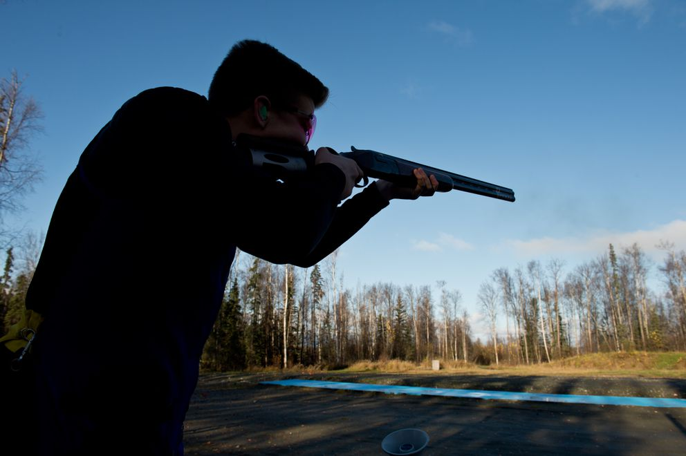 Grayson Davey of Anchorage takes aim at a target while training at the Birchwood Recreation and Shooting Park. (Marc Lester / Alaska Dispatch News)