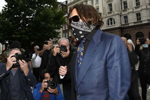 "Johnny Depp arrives at the High Court in London, Thursday, July 9, 2020. Johnny Depp is back in the witness box for a third day at the trial of his libel suit against a tabloid newspaper that called him a ""wife-beater."" Depp is suing News Group Newspapers, publisher of The Sun, and the paper's executive editor, Dan Wootton, over an April 2018 article that said he'd physically abused ex-wife Amber Heard. He strongly denies ever hitting Heard. (AP Photo/Alberto Pezzali)"