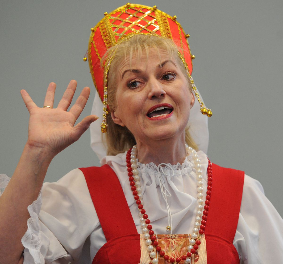 Zlata Lund sings with the Russian American Colony Singers as they perform a traditional Russian song at the Mountain View Library on Thursday. (Bill Roth / Alaska Dispatch News)