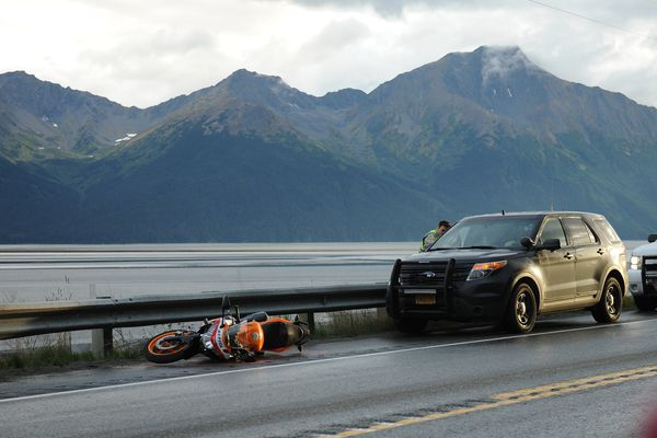 A motorcycle lies on the side of the Seward Highway near the scene of a fatal motorcycle crash near Girdwood on Saturday, Sept. 9, 2017. (Bob Hallinen / Alaska Dispatch News)