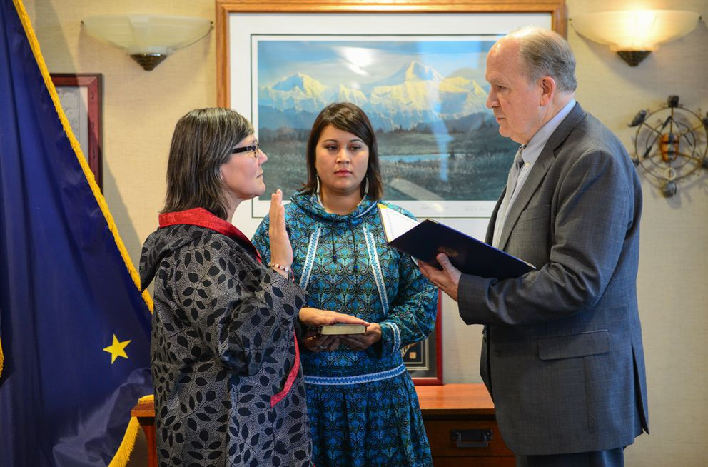 Valerie Nurr'araaluk Davidson (left), Director of Rural and Native Affairs Barbara Blake (center), and Gov. Bill Walker (right) participate in a swearing-in ceremony Tuesday as Davidson replaced Byron Mallott as lieutenant governor. (Office of Gov. Walker photo)