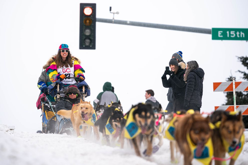 Kasilof musher Monica Zappa crests a hill on Cordova Street during the ceremonial start of the Iditarod a week and a half ago. (Loren Holmes / ADN)