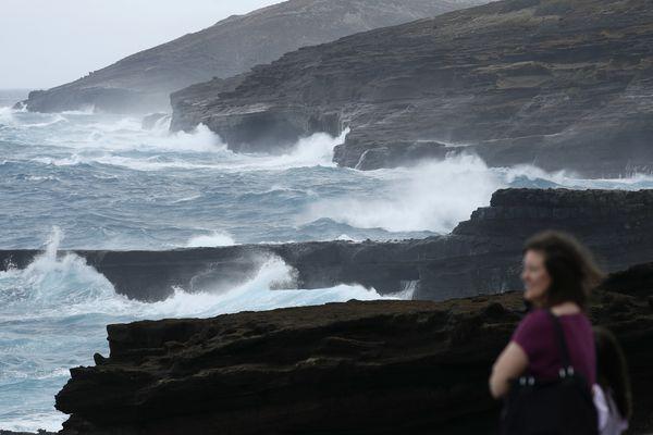 Waves crash on a rocky coastline ahead of Hurricane Lane, Friday, Aug. 24, 2018, near Honolulu. As Hurricane Lane approaches Oahu, large ocean swells have impacted local beaches and coastlines. (AP Photo/John Locher)