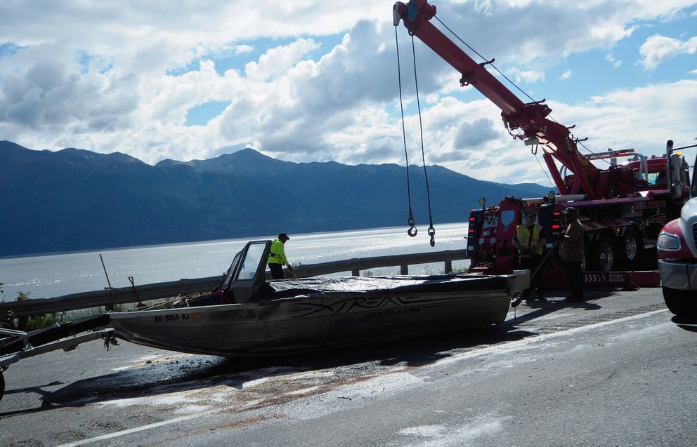 Crews clear wreckage from a multiple vehicle accident on the Seward Highway at Mile 109 on July 9, 2017. (Marc Lester / Alaska Dispatch News)
