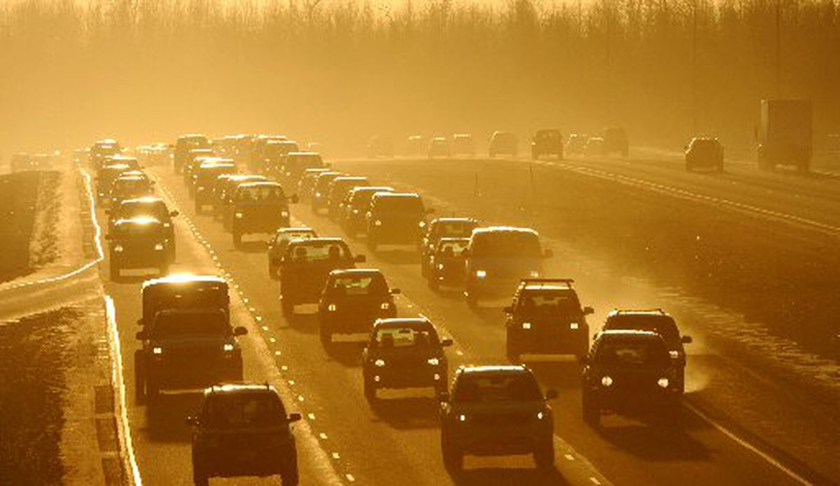 Commuter traffic on the Glenn Highway near the JBER-Richardson overpass kicks up a cloud of dust on Feb. 10, 2014. (BILL ROTH / ADN archive 2014)