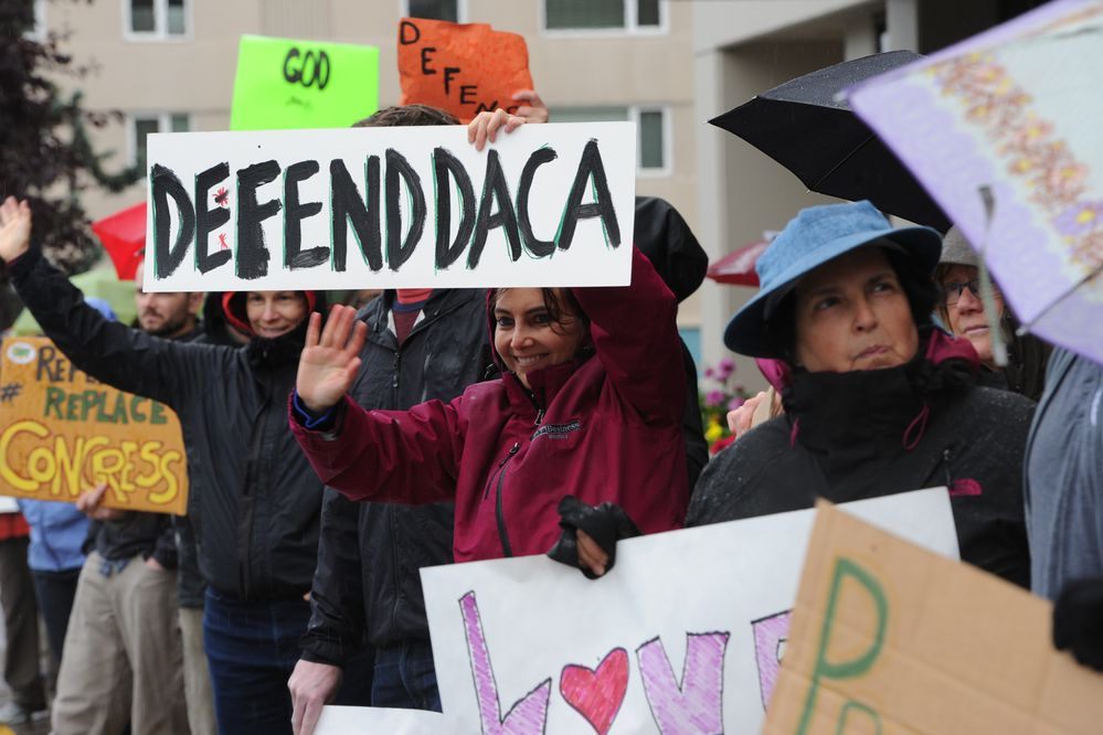 Ana Lavagnino, center, who said she is a daughter of an immigrant, shows her support for DACA Deferred Action for Childhood Arrivals during a rally in Anchorage on Tuesday, Sept. 5, 2017, in the wake of President Trump's announcement to end protection for hundreds of thousands of