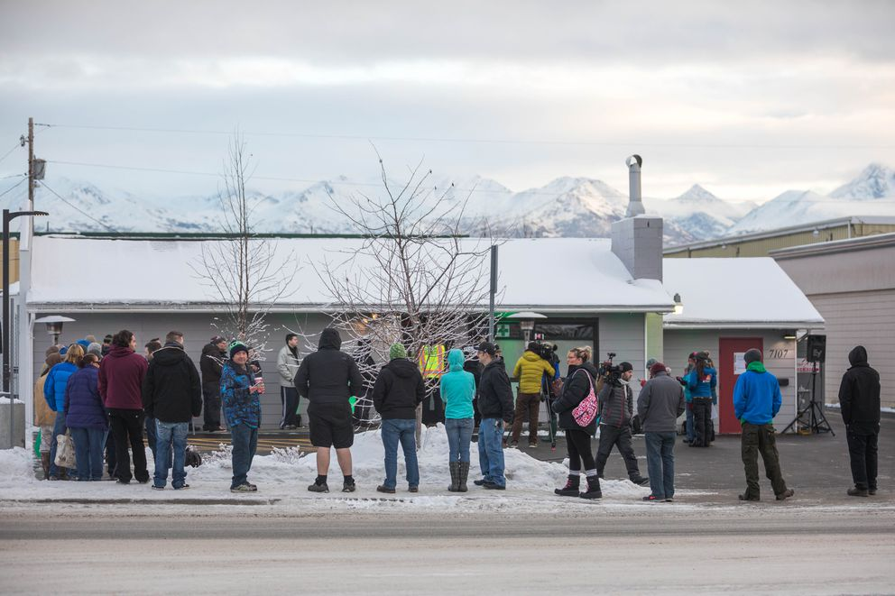 Customers wait to enter Arctic Herbery on Thursday, Dec. 15, 2016. Arctic Herbery was the first legal marijuana retail store to open in Anchorage, Alaska's largest city. (Loren Holmes / Alaska Dispatch News)