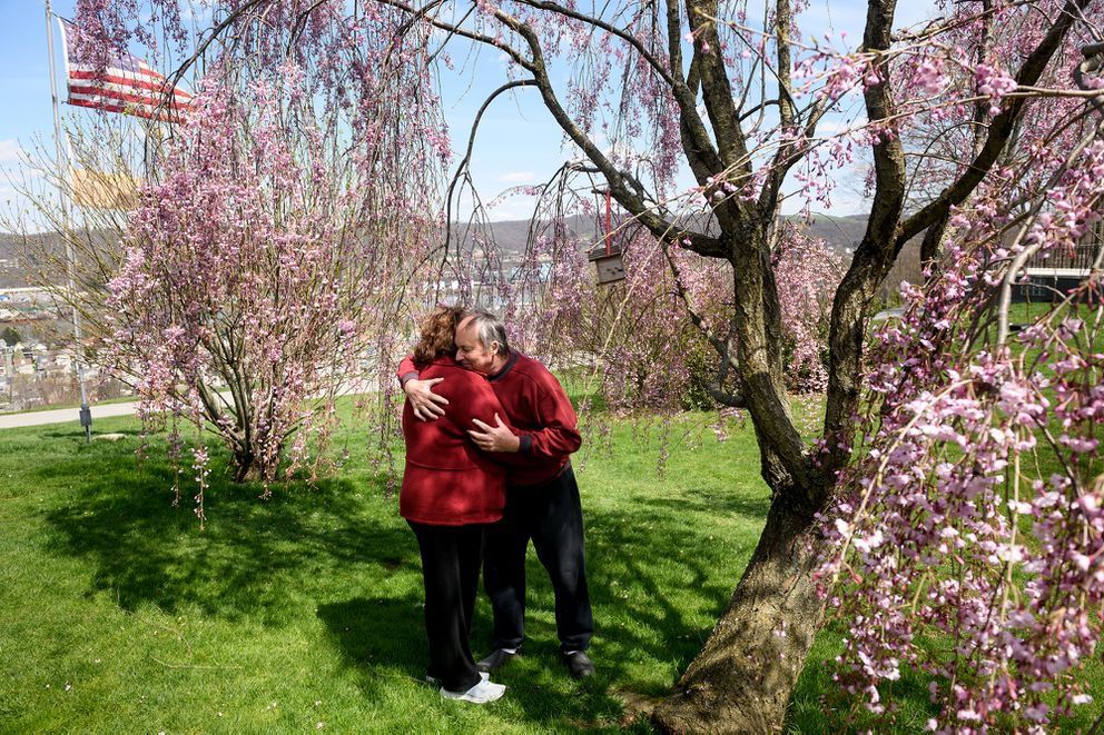 Steve Sluzynsky gives his wife, Connie a hug as they stand in the yard of their home on in April in Monaca, Pa. Sluzynsky pulled her 83-year-old mother out of the Brighton Rehabilitation and Wellness Center in Beaver, Pa., where officials have warned that all 450 residents and 300 staff members could be infected with the covid-19 virus. (Photo by Justin Merriman for The Washington Post)