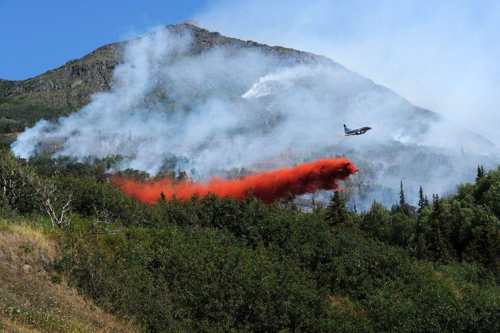 A Convair CV580 air tanker drops fire retardant on the McHugh Creek wildfire below McHugh Peak on Tuesday afternoon, July 19, 2016, along Turnagain Arm. (Erik Hill / Alaska Dispatch News)