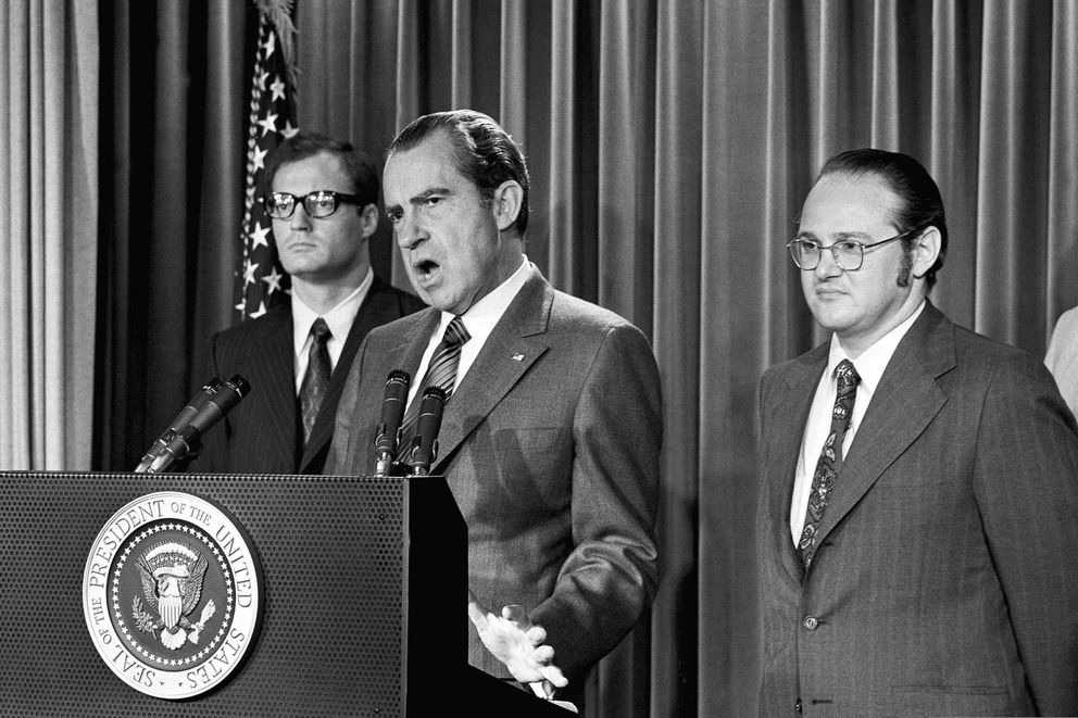 FILE - In this June 17, 1971, file photo, President Richard Nixon explains aspects of the special message sent to the Congress, asking for an extra $155 million for a new program to combat the use of drugs. He labeled drug abuse 'a national emergency ' and said the money would be used to 'tighten the noose around the necks of drug peddlers and thereby loosen the noose around the necks of drug users. ' At left is Egil Krogh, deputy director of the Domestic Council. At right is Dr. Jerome Jaffe, who was recruited by Nixon to lead a new drug strategy. (AP Photo/Harvey Georges, File)