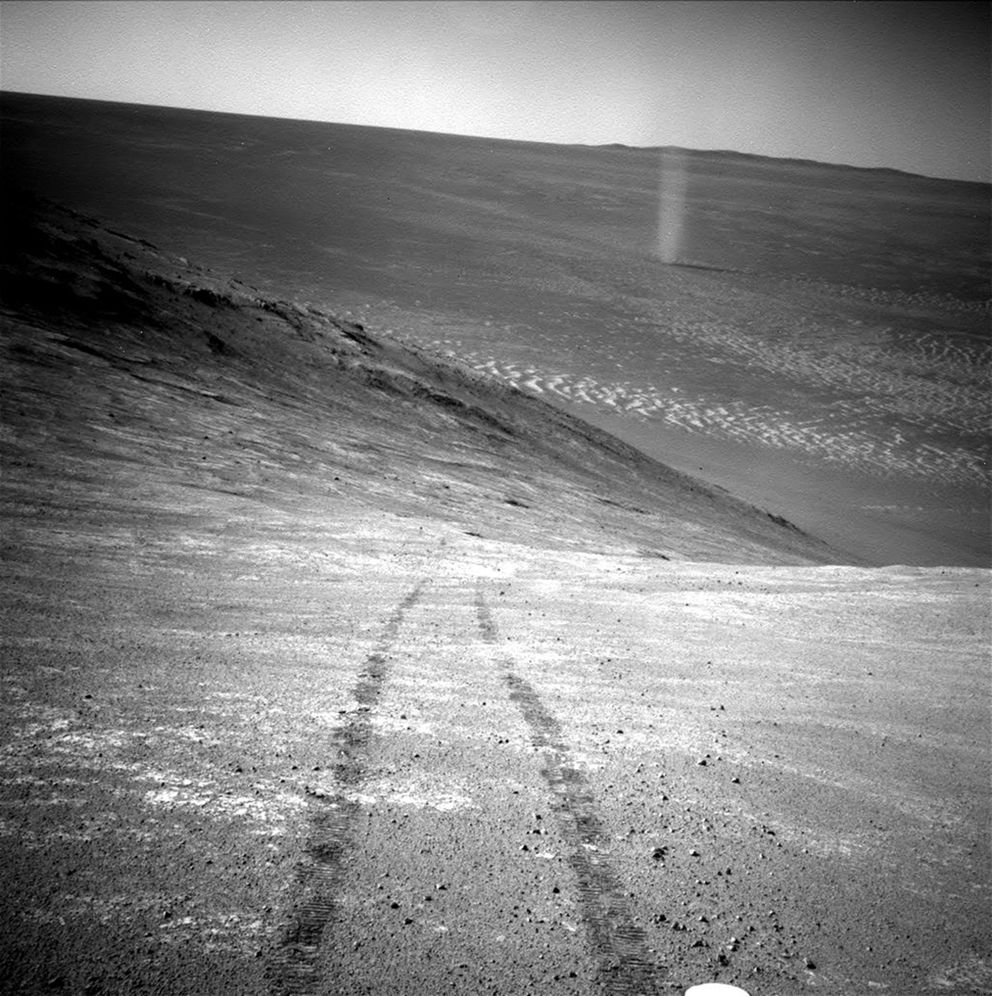 From its perch high on a ridge, Opportunity recorded this image of a Martian dust devil twisting through the valley below. The view looks back at the rover's tracks leading up the north-facing slope of Knudsen Ridge in Marathon Valley. Handout courtesy of NASA/JPL-Caltech