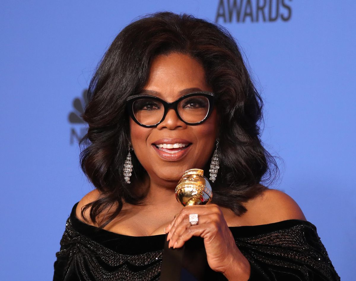 FILE – Oprah Winfrey poses backstage at the Golden Globe awards with her Cecil B. DeMille Award. REUTERS/Lucy Nicholson