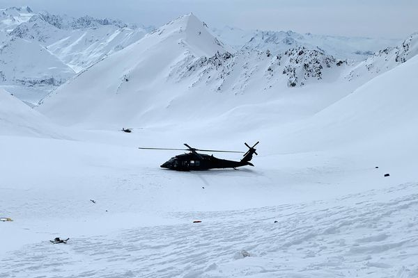 An Alaska Army National Guard helicopter responded to the helicopter crash in the Chugach Mountains, near the Knik Glacier, Sunday, March 28, 2021. (Alaska Mountain Rescue Group photo via Alaska State Troopers)