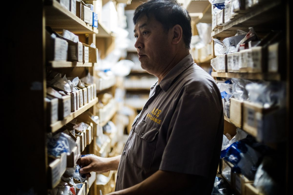 Chun B. Park searches for a needed part in his back stockroom. (Young Kim / Alaska Dispatch News)