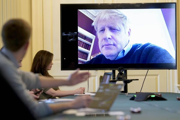 FILE - In this Saturday, March 28, 2020 handout photo provided by Number 10 Downing Street, Britain's Prime Minister Boris Johnson chairs the morning Covid-19 Meeting remotely after self isolating after testing positive for the coronavirus, at 10 Downing Street, London. British Prime Minister Boris Johnson has been admitted to a hospital with the coronavirus. Johnson's office says he is being admitted for tests because he still has symptoms 10 days after testing positive for the virus. (Andrew Parsons/10 Downing Street via AP, File)