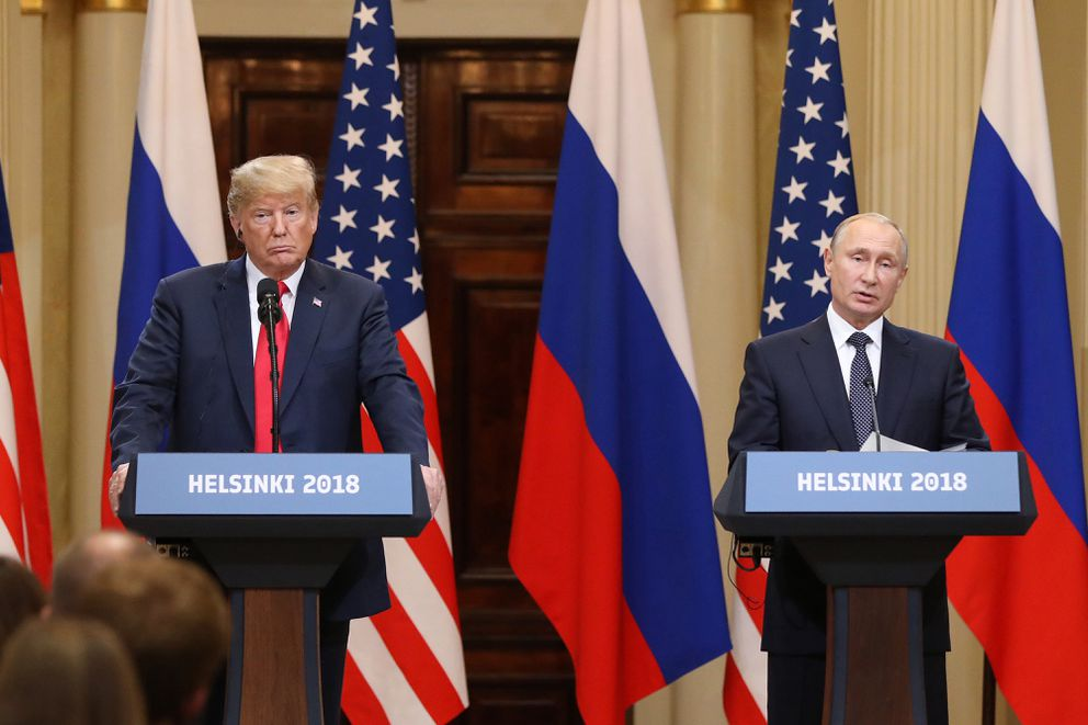 President Donald Trump, left, listens as Vladimir Putin, Russia's president, speaks during a news conference in Helsinki, Finland, on July 16, 2018. Bloomberg photo by Chris Ratcliffe