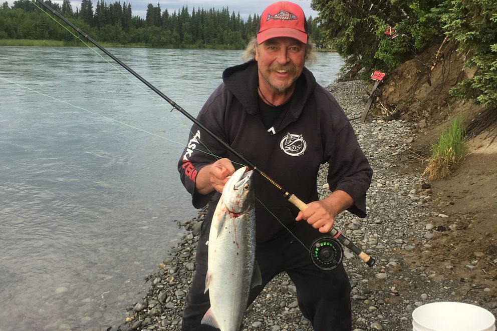 Phillip Keltner shows off his salmon catch on the Funny River July 9, 2017. Keltner's family flew from Colorado and California to assist in the search effort after he was ejected from a boat on the Kenai River Friday night, August 4, 2017. (Courtesy Jess Keltner)