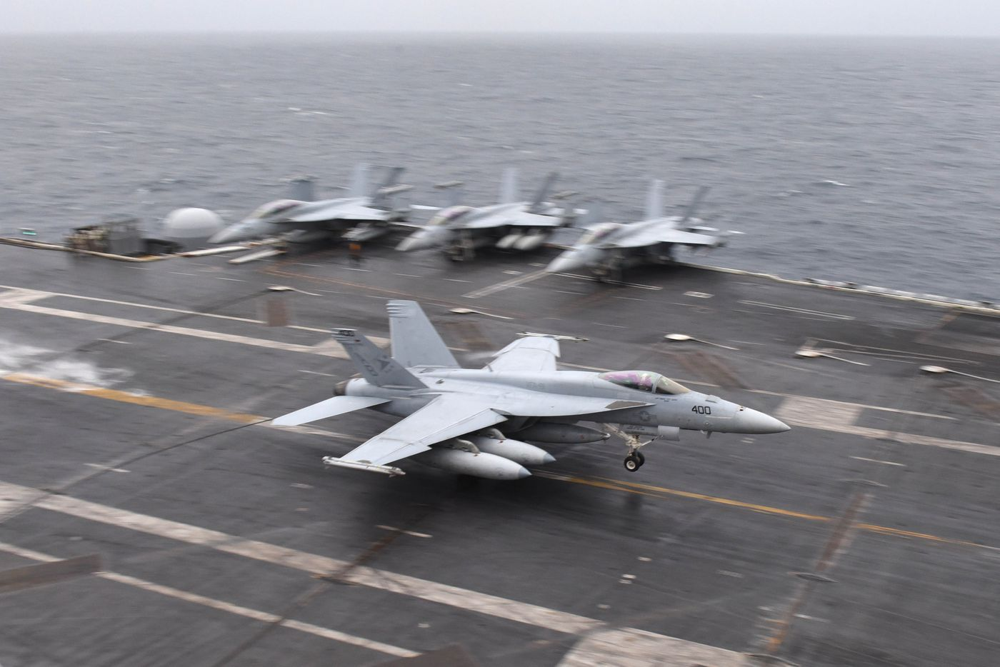 An F/A-18E Super Hornet assigned to the Sunliners of Strike Fighter Squadron 81 lands on the flight deck aboard the Nimitz-class aircraft carrier USS Harry S. Truman. For the first time in nearly 30 years, a U.S. aircraft carrier has entered the Arctic Circle. (U.S. Navy photo by Mass Communication Specialist Seaman Maxwell Higgins)