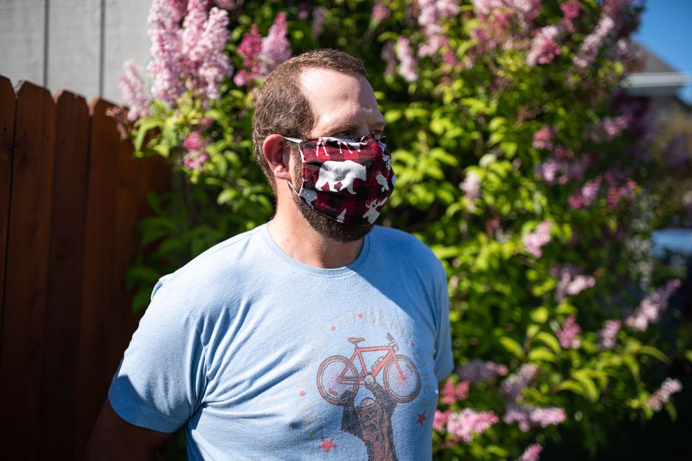 Roger Parr poses for a photo outside his West Anchorage home on Saturday, June 27, 2020. Parr is diabetic and bikes to stay healthy, and he described feeling relieved after the Municipality of Anchorage ordered mask wearing in indoor public spaces. (Loren Holmes / ADN)