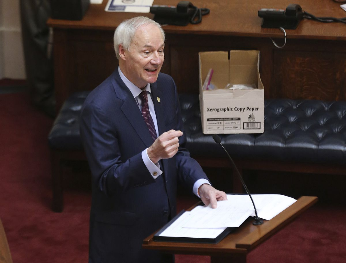 In this April 8, 2020, photo, Arkansas Gov. Asa Hutchinson gives the State of the State in the senate chamber of the state Capitol in Little Rock, Ark. Hutchinson vetoed legislation that would have made his state the first to ban gender confirming treatments for transgender youth. (Tommy Metthe / Arkansas Democrat-Gazette via AP, File)
