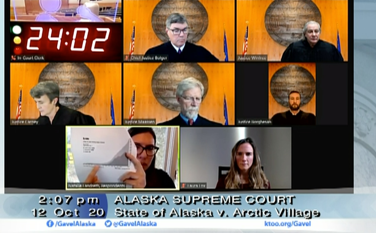 Natalie Landreth, an attorney for the Native American Rights Fund, points to Alaska's COVID-19 case counts on Monday, Oct. 12, 2020 in a hearing of the Alaska Supreme Court. (Screenshot)