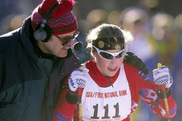 East High skier Kikkan Randall prepares to start the girl's 5k classical race at the Alaska State Cross Country Meet with words of encouragement from official Wally Smith on February 25, 2000. (Marc Lester / ADN)