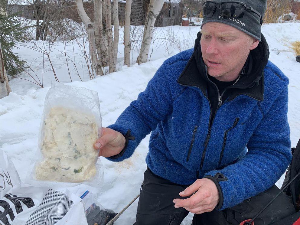 Swedish musher Mats Pettersson was eating pasta in Shageluk. Photographed on March 8, 2019. (Tegan Hanlon / ADN)