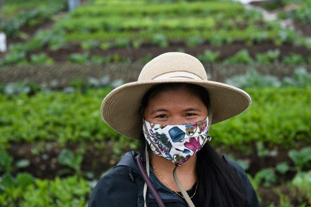 Cherry Tacang stands in front of her growing plot at Grow North Farm on Friday, June 26, 2020. (Marc Lester / ADN)
