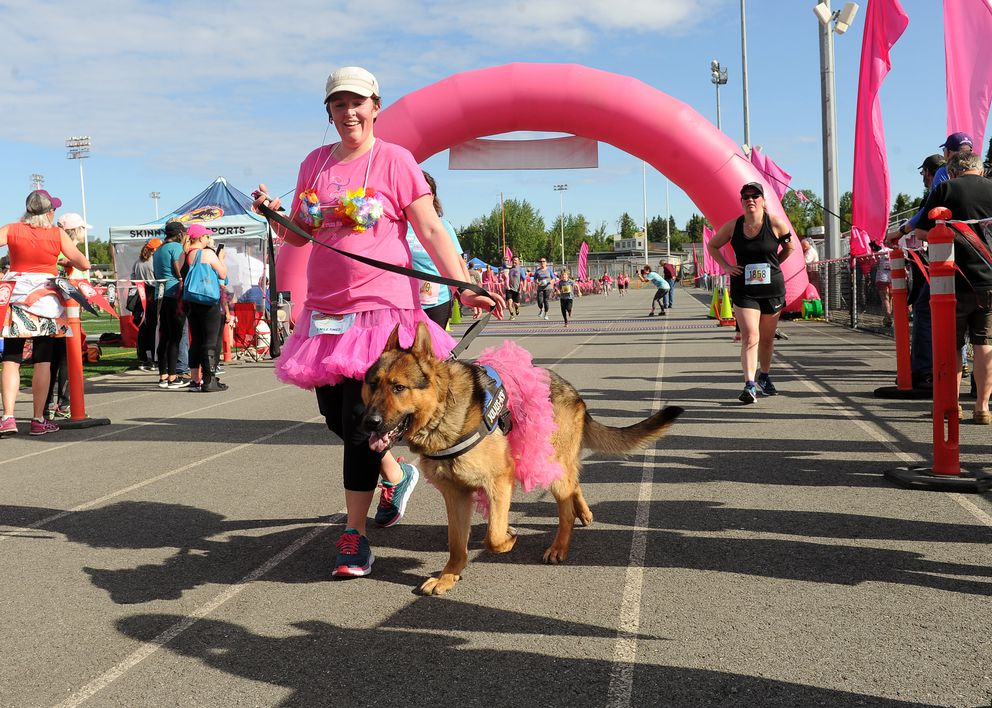Ruger the dog crosses the finish line. (Bob Hallinen / ADN)