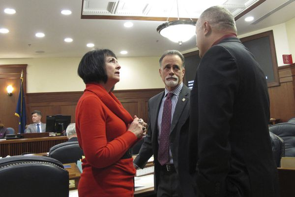 From left, Alaska state Senators Shelley Hughes, R-Palmer, Peter Micciche, R-Soldotna, and Mike Shower, R-Wasilla, speak during a break on the Senate floor, Tuesday, Jan. 21, 2020, in Juneau, Alaska, on the first day of the 2020 legislative session. (AP Photo/Becky Bohrer)