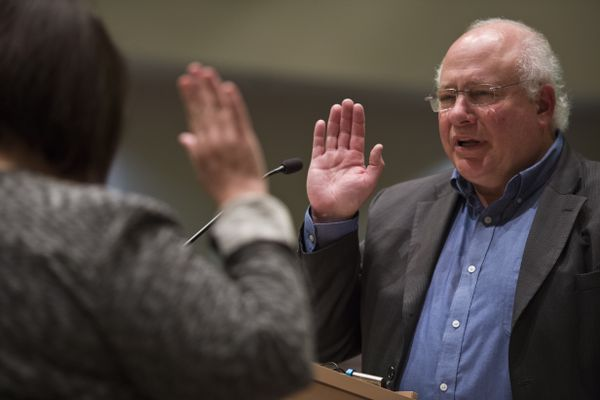 Ira Perman is sworn in after he won an interim appointment to the Anchorage Assembly on July 10, 2018. (Marc Lester / ADN)