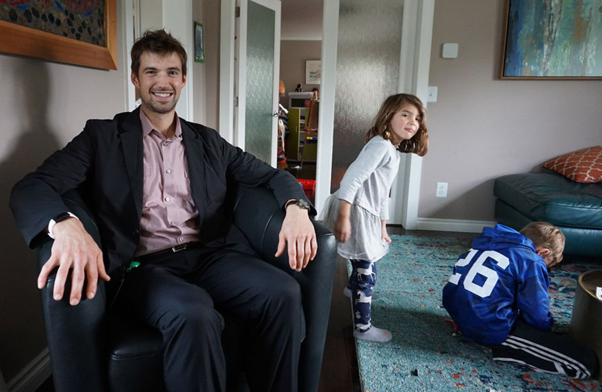 BP employee Joe Miller in his Anchorage home with his children Hadley, 5, and Liam, 8. (Photo by Elizabeth Harball/Alaska's Energy Desk)