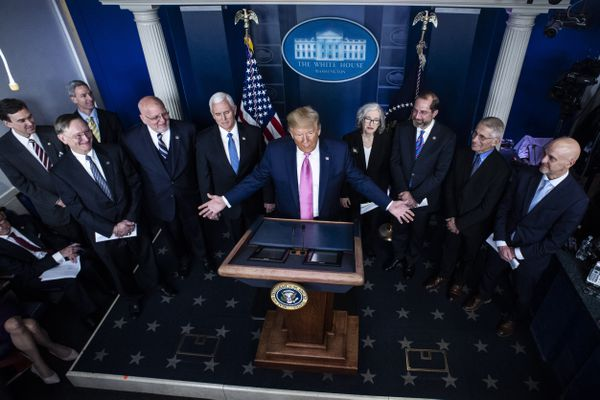 President Donald Trump, flanked by Vice President Mike Pence and members of the Coronavirus Task Force, speak at a news conference at the White House on Wednesday. MUST CREDIT: Washington Post photo by Jabin Botsford