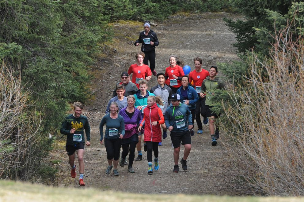 Participants near the finish of the of the Olin Turbo and Mom family fun run, a 2K race on the ski trails at Service High School. (Bill Roth / ADN)
