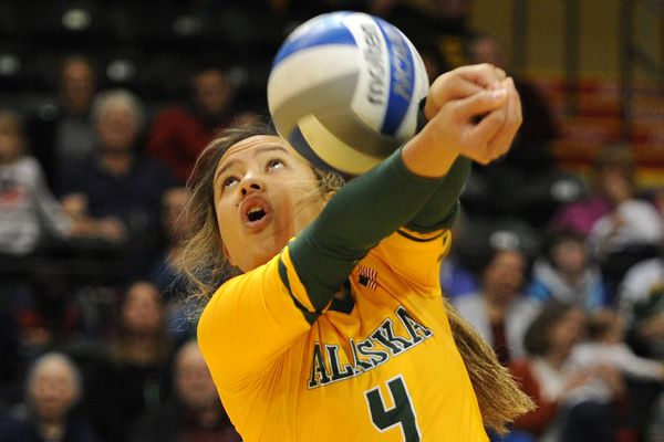 UAA senior Keala Kaio-Perez makes a pass during a game against UAF at the Alaska Airlines Center on Tuesday, Nov. 14, 2017. (Bill Roth / Alaska Dispatch News)