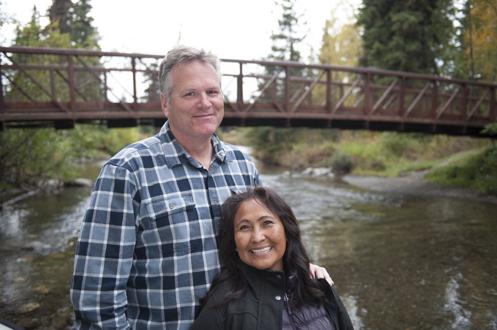 In this photo taken Sept. 16, 2018, Alaska Gov.-elect Mike Dunleavy and his wife Rose pose by a bridge in Anchorage, Alaska. For the first time ever, a U.S. governor will be sworn into office above the Arctic Circle. Gov.-elect Mike Dunleavy will become Alaska's top elected official Dec. 3, when he takes the oath of office in Noorvik, a tiny Inupiat Eskimo village above the Arctic Circle and more than a thousand miles from the state capital of Juneau. Noorvik is where Dunleavy's Alaska Native wife , Rose, grew up, and where residents still travel by dogsled and hunt and fish for much of their food. (Aaron Weaver via AP)