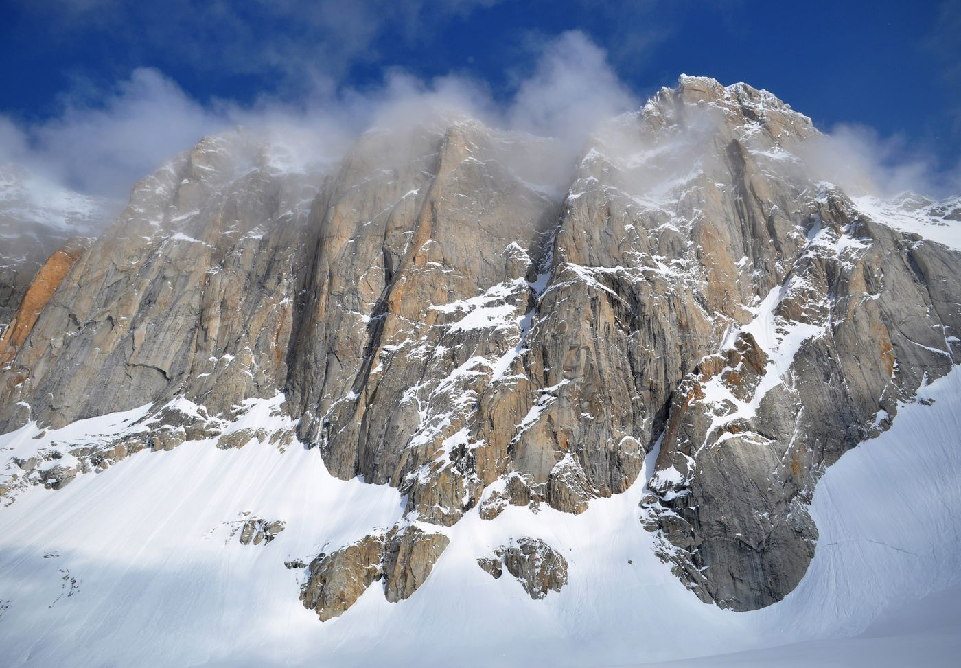 Clouds drift above the south face of the Moose's Tooth. (Vicky Ho / ADN)