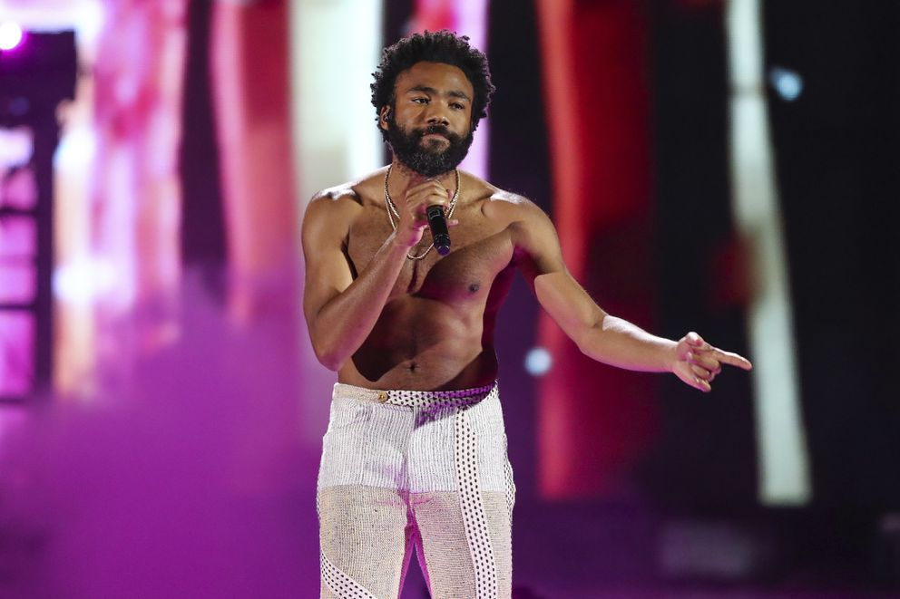 FILE - In this Friday, Sept. 21, 2018 file photo, Childish Gambino performs at the 2018 iHeartRadio Music Festival Day 1 held at T-Mobile Arena in Las Vegas. A list of nominees in the top categories at the 2019 Grammys, including Kendrick Lamar, who is the leader with eight nominations, were announced Friday, Dec. 7, 2018, by the Recording Academy. Drake, Cardi B, Brandi Carlile, Childish Gambino, H.E.R., Lady Gaga, Maren Morris, SZA, Kacey Musgraves and Greta Van Fleet also scored multiple nominations. (Photo by John Salangsang/Invision/AP, File)