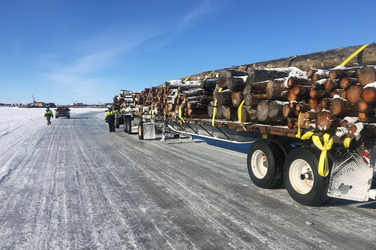 A truck transports raw lumber on the ice road near Bethel in March 2017. (Mark Leary photo)