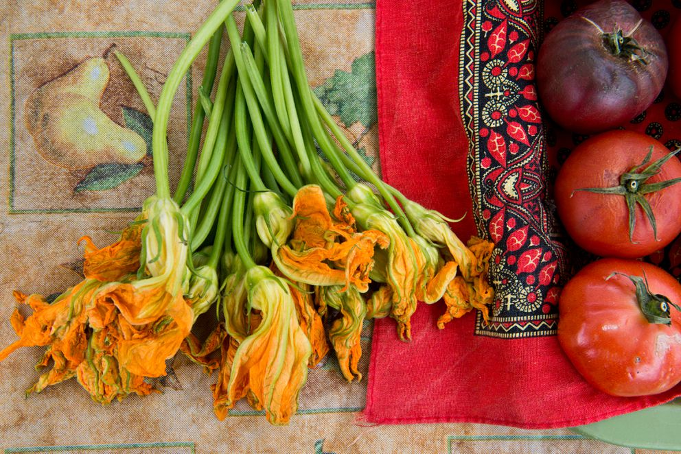 Squash blossoms and tomatoes. (Marc Lester / ADN)