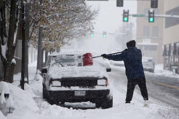 John Woodrum, shovels his car on Sunday, Dec. 9, 2018, in Roanoke, Va. A massive storm brought snow, sleet, and freezing rain across a wide swath of the South on Sunday — causing dangerously icy roads, immobilizing snowfalls and power losses to hundreds of thousands of people. (Stephanie Klein-Davis /The Roanoke Times via AP)