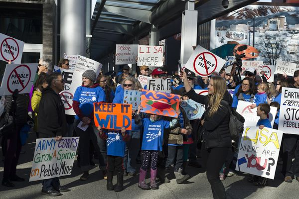 Opponents of the proposed Pebble Project mining development gathered to protest outside the Dena'ina Convention Center in downtown Anchorage on April 19, 2018. (Marc Lester / ADN)