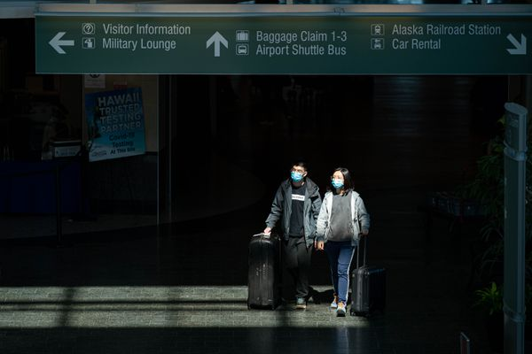 People walk through the baggage claim level of Ted Stevens Anchorage International Airport on Wednesday, May 26, 2021. (Loren Holmes / ADN)